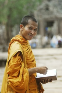 Buddhist monks, who still come to worship in some of the temples, have become usual fixtures in Angkor